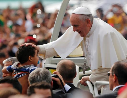 Pope Blesses Child on World Youth Day
