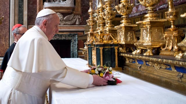 PHOTO: Pope Francis puts flowers on the altar inside St. Mary Major Basilica, in Rome, March 14, 2013.