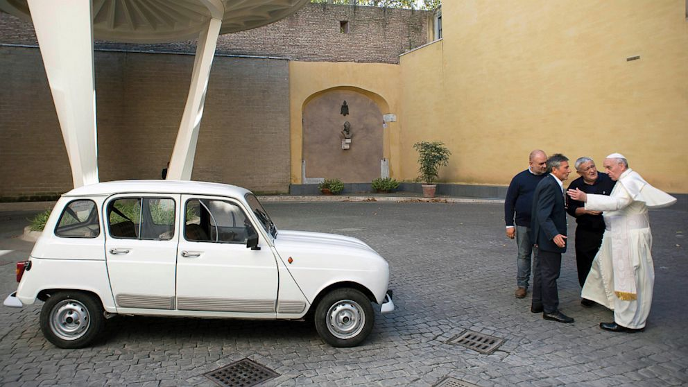 PHOTO: Pope Francis and donated Renault 4L