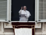 PHOTO: Pope Francis blesses the crowd in St. Peters Square after saying the Angelus prayer at the Vatican, Sunday, March 17, 2013.