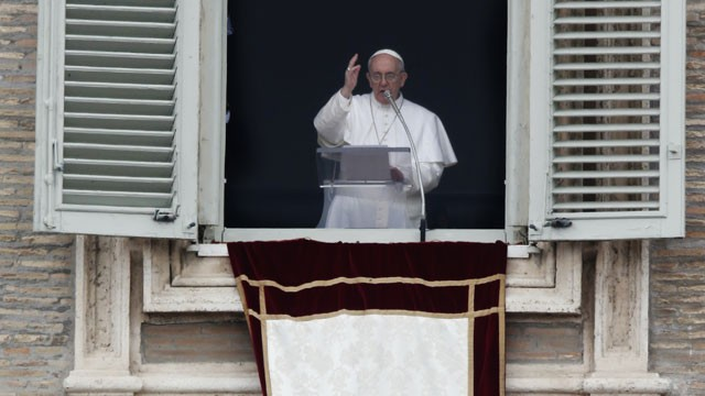 PHOTO: Pope Francis blesses the crowd in St. Peter's Square after saying the Angelus prayer at the Vatican, Sunday, March 17, 2013.