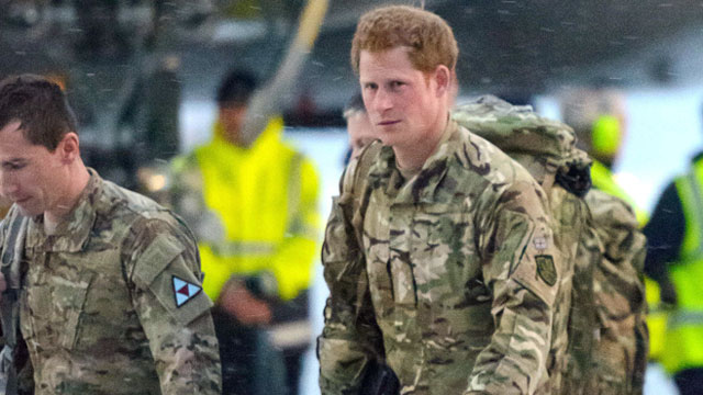 PHOTO: Britains Prince Harry, right, disembarks from a Voyager transport aircraft following its