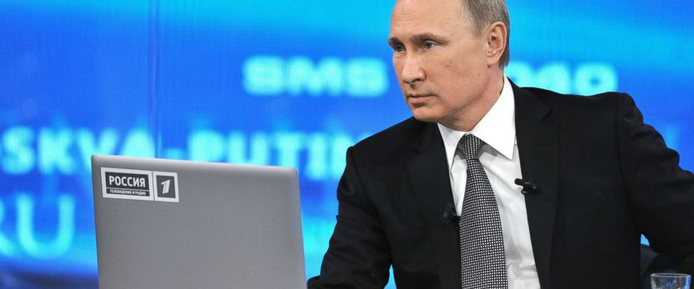 """PHOTO: Russian President Vladimir Putin speaks during an annual call-in show on Russian television """"Conversation With Vladimir Putin"""" in Moscow, Russia, April 16, 2015."""
