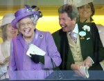 PHOTO: Britains Queen Elizabeth II with her racing manager John Warren react after her horse, Estimate, won the Gold Cup on day three of the Royal Ascot meeting at Ascot Racecourse, England, June 20, 2013.