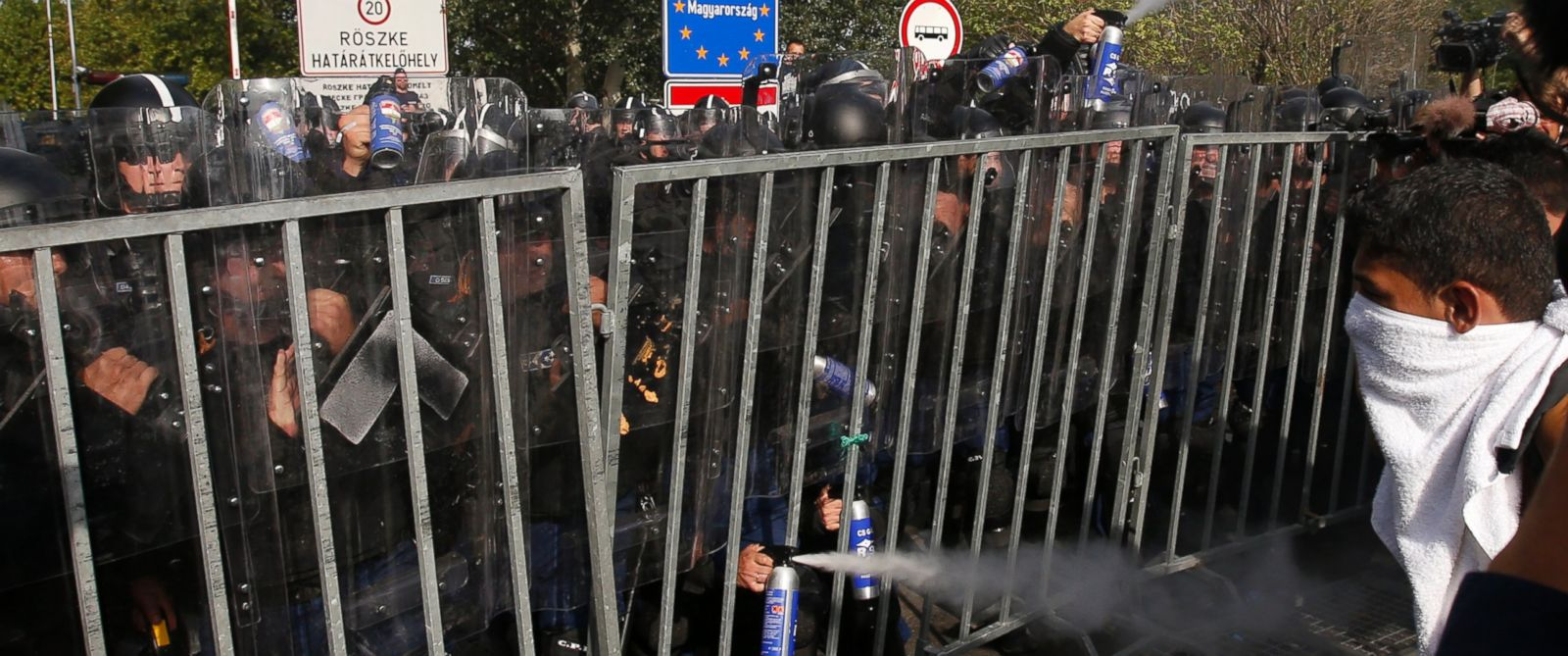 """PHOTO: Hungarian police use pepper spray on refugees at the """"Horgos 2"""" border crossing into the Hungary, near Horgos, Serbia, Sept. 16, 2015."""
