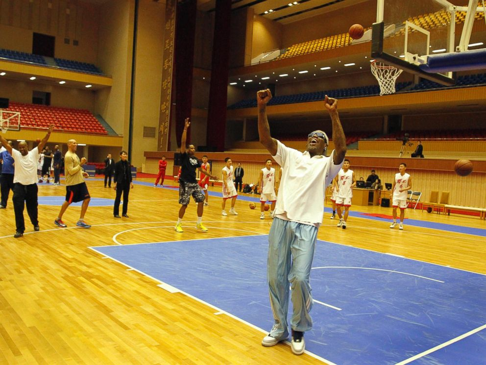 PHOTO: Dennis Rodman cheers after a fellow U.S. basketball player makes a jump shot during a practice session with North Korean players in Pyongyang, North Korea on Jan. 7, 2014.