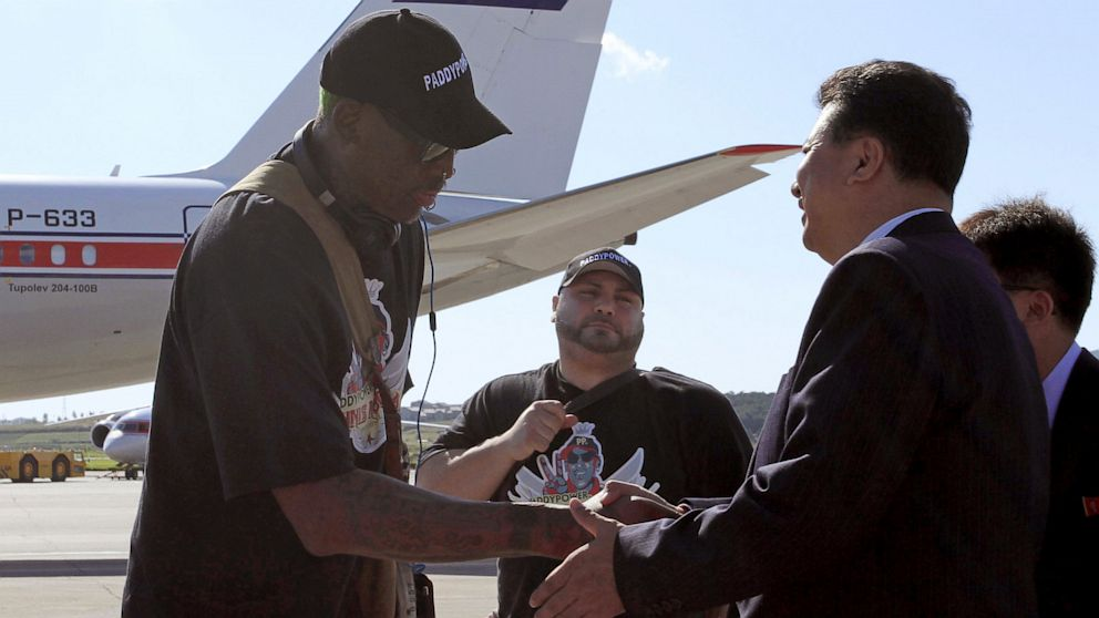 PHOTO: Former NBA star Dennis Rodman, left, is greeted by Son Kwang Ho, vice-chairman of North Koreas Olympic Committee, at Pyongyang airport, North Korea on Sept. 3, 2013.