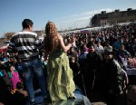 "PHOTO: People watch Roma girl and boy, from the Kalaidzhi community, dance on the trunk of a car, during the so called ""Roma bridal market,"" March 23, 2013."