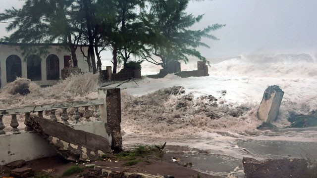 PHOTO: Waves, brought by Hurricane Sandy, crash on a house in the Caribbean Terrace neighborhood in eastern Kingston, Jamaica, Wednesday, Oct. 24, 2012.