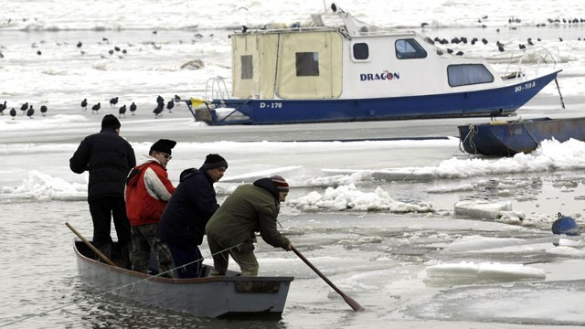PHOTO: People break the ice on a frozen part of Danube River, in Belgrade, Serbia, Feb. 20, 2012.