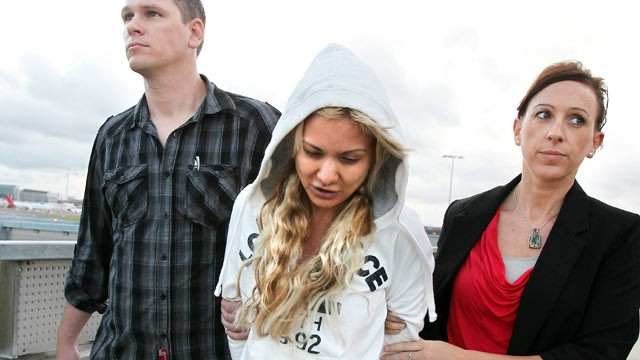 PHOTO: Simone Farrow arrives at the domestic terminal of Sydney airport in Sydney, Australia, in police custody following her arrest on drug trafficking charges, March 14, 2012.