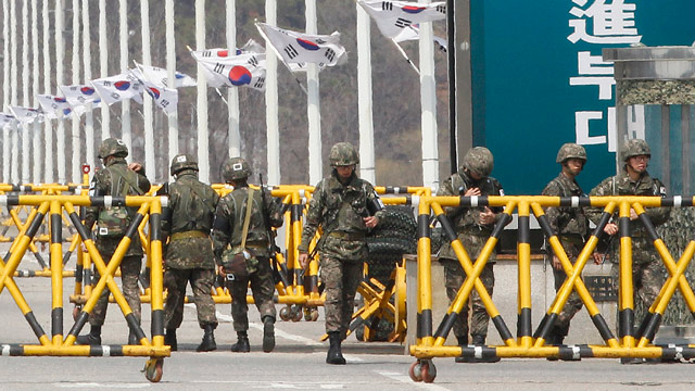 PHOTO: South Korean army soldiers stand guard on Unification Bridge in Paju, South Korea, near the border village of Panmunjom, Saturday, April 13, 2013.