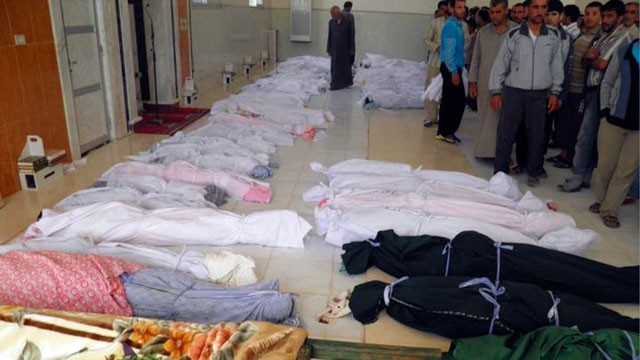 PHOTO: This citizen journalism image provided by Shaam News Network, May 26, 2012 purports to show shrouded dead bodies following a Syrian government assault on Houla, Syria.