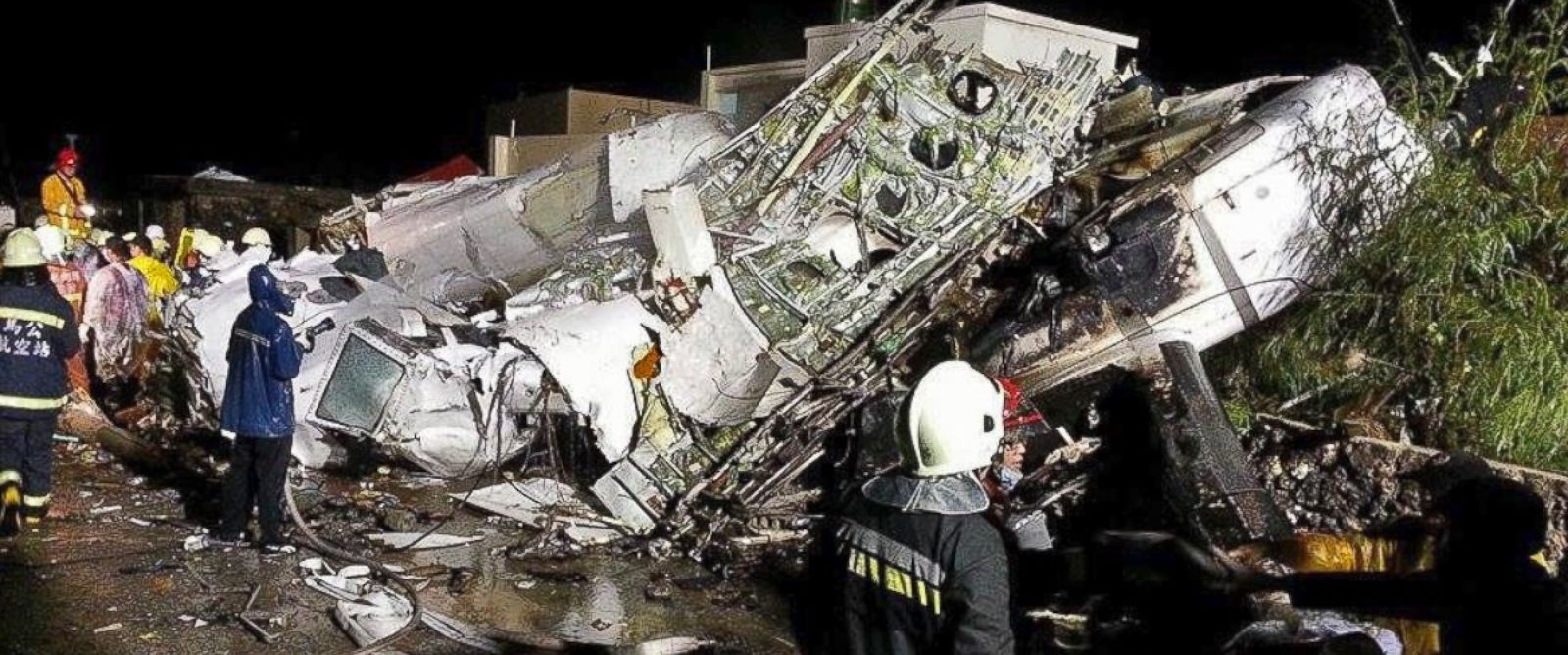 PHOTO: Rescue workers survey the wreckage of TransAsia Airways flight GE222 which crashed while attempting to land in stormy weather on the Taiwanese island of Penghu, July 23, 2014.