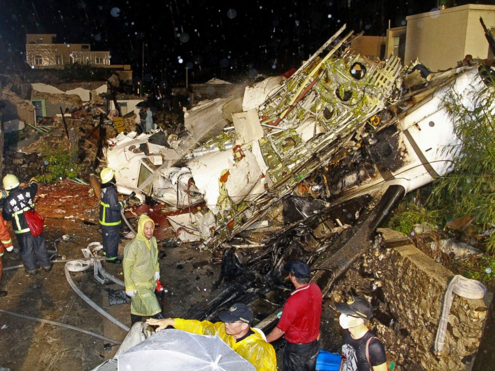 PHOTO: Rescue workers work next to the wreckage of TransAsia Airways flight GE222 which crashed while attempting to land in stormy weather on the Taiwanese island of Penghu, July 23, 2014.