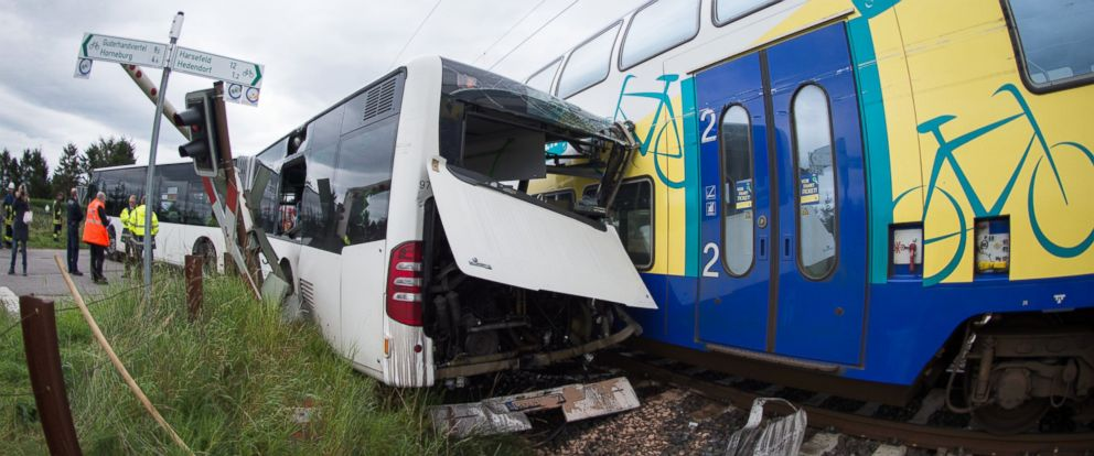 PHOTO: The wreckage of a school bus and a train stand on a railway crossing near Buxtehude, northern Germany, Sept. 16, 2015.