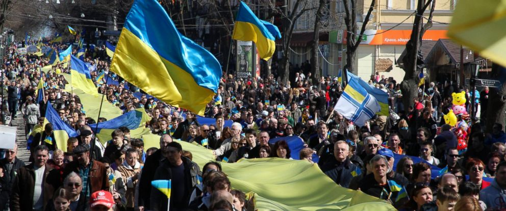 PHOTO: Demonstrators carry a huge Ukrainian national flag during an anti-war protest in the Black Sea port of in Odessa, Ukraine, Sunday, March 30, 2014.