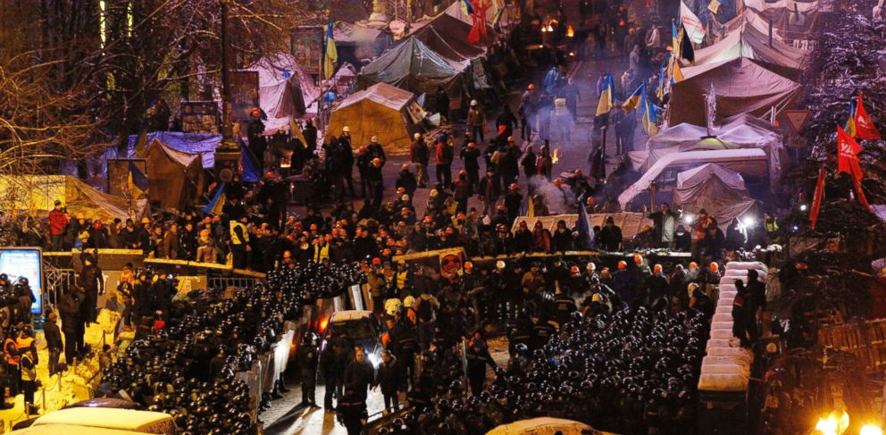 PHOTO: Riot policemen block Pro-European Union activists camping out in their tents on the Independence Square in Kiev, Ukraine, Dec. 11, 2013.