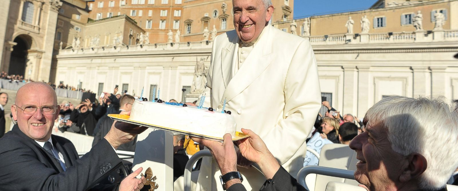 PHOTO: In this photo provided by Vatican newspaper LOsservatore Romano, Pope Francis is presented with a cake during his weekly general audience in St. Peters Square at the Vatican on Dec. 17, 2014.