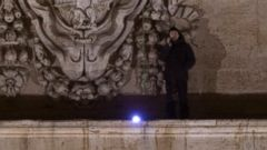 PHOTO: Italian entrepreneur Marcello di Finizio talks on the phone as he stands on the facade of St. Peter?s Cathedral at the Vatican, Sunday, Dec. 21, 2014.