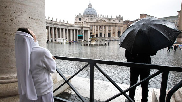 PHOTO: A nun watches the rain in St. Peters Square during the second day of the conclave to elect a new pope at the Vatican, March 13, 2013.