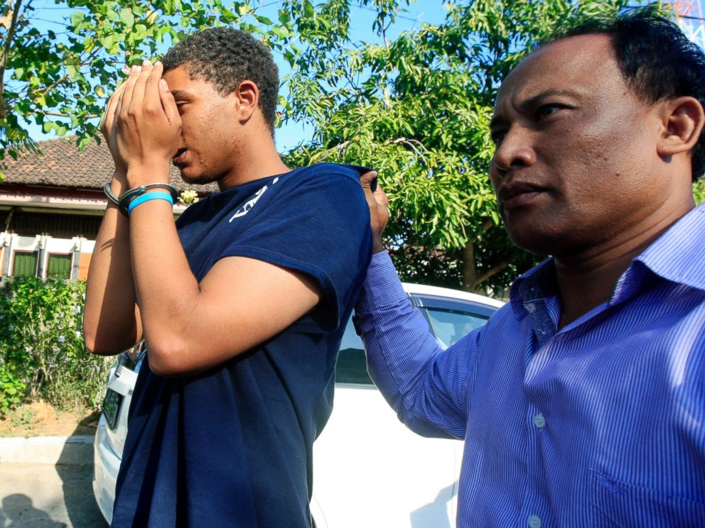 PHOTO: An Indonesian police officer escorts Tommy Schaefer, left, as he is brought to the police station for questioning in relation to the death of his girlfriends mother, in Bali, Indonesia, Aug. 13, 2014.