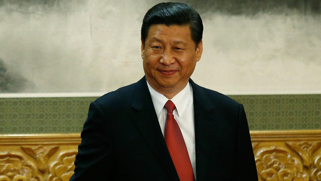 PHOTO: New Communist Party General Secretary Xi Jinping smiles as the new members of the Politburo Standing Committee applaud in Beijings Great Hall of the People, Nov. 15, 2012.