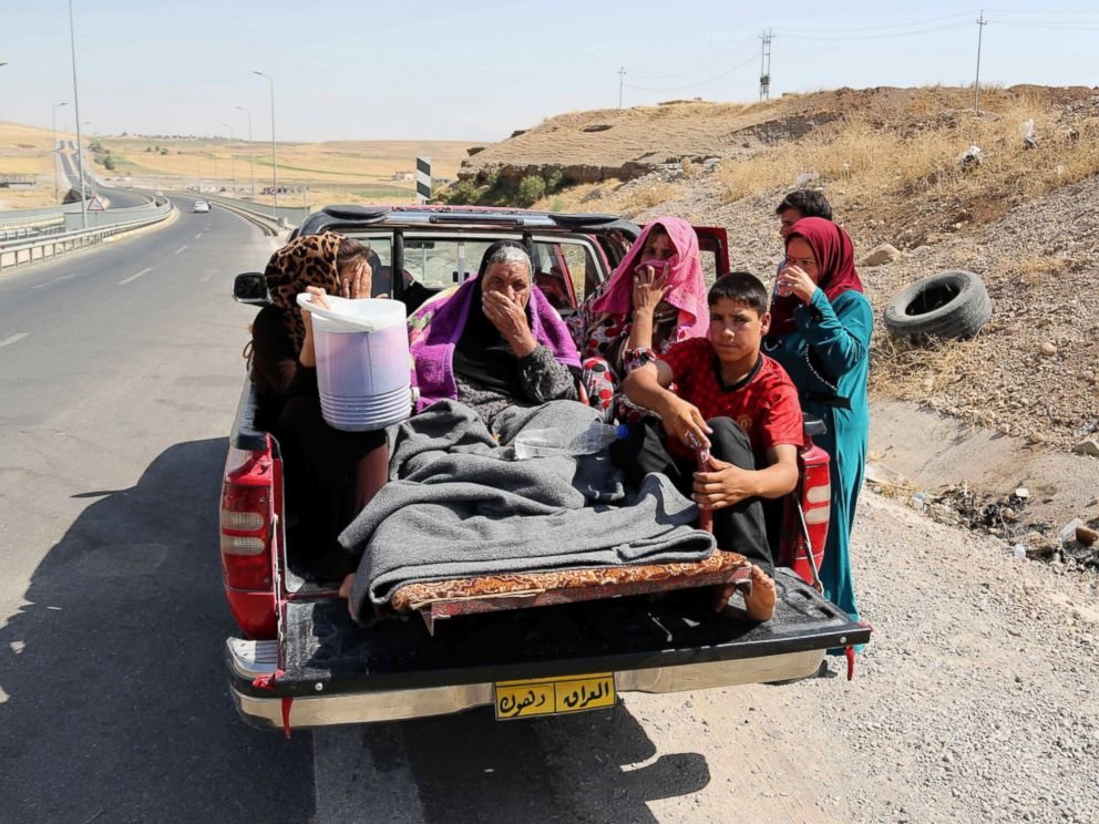 PHOTO: Displaced Iraqis ride on a truck on a mountain road near the Turkish-Iraq border, outside Dahuk, in Iraq Saturday, Aug. 9, 2014.