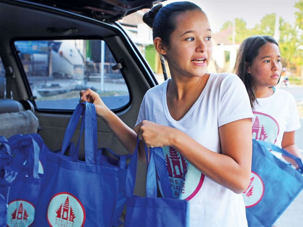PHOTO: Melati Riyanto Wijsen, 14, and her sister, Isabel Sari Riyanto Wijsen, 12, started Bye Bye Plastic Bag in Bali, Indonesia. Teen members clean up roadsides, beaches, and tourist sites.