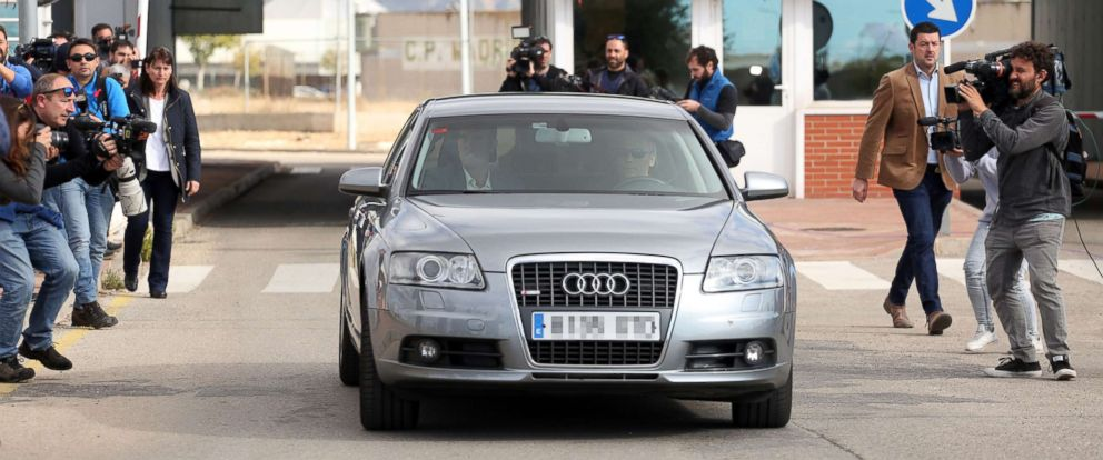 PHOTO: Photographers follow after the car transporting former speaker of Catalonias dissolved regional parliament Carme Forcadell as it leaves the Alcala Meco jail in Madrid on November 10, 2017. She was released after supporters posted her bail.