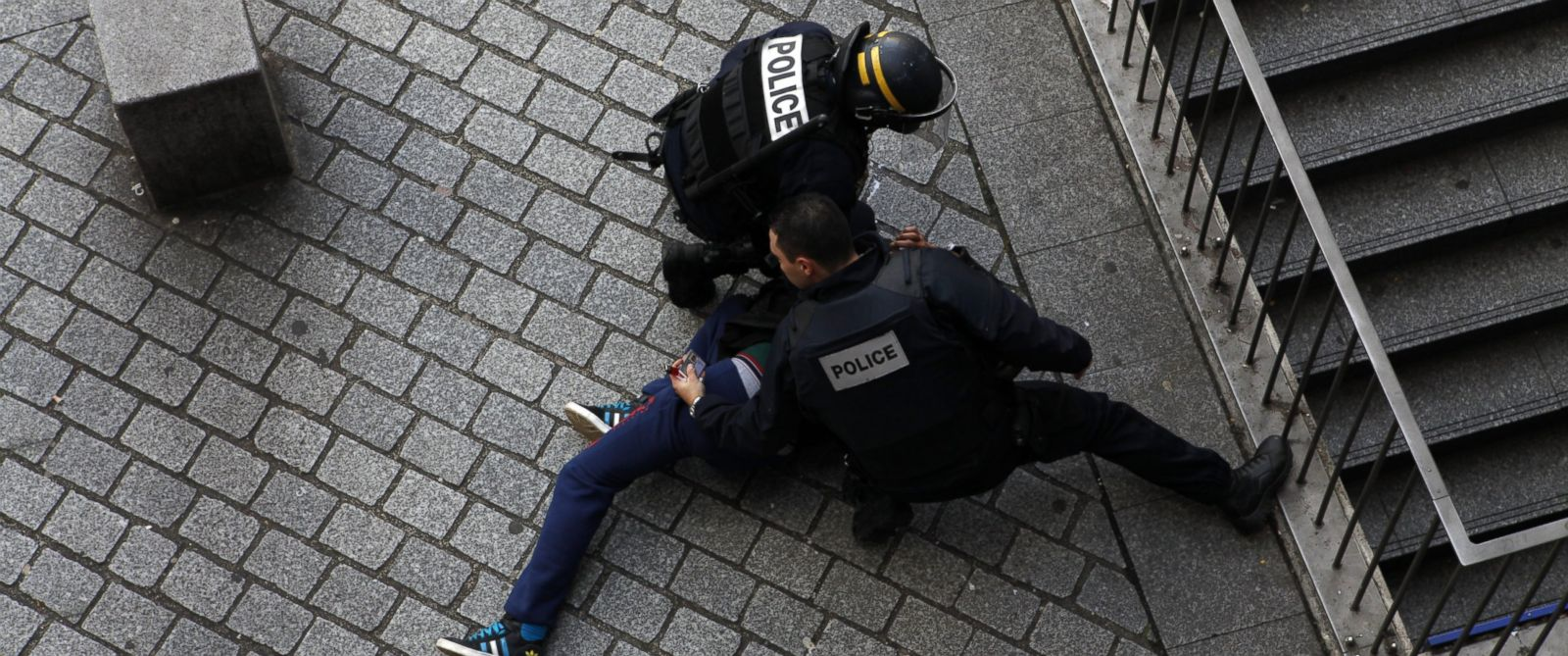 PHOTO: French police detain a man in Saint-Denis, outside Paris, in conjunction with a raid on an apartment while searching for the mastermind behind last Fridays terror attacks, Nov. 18, 2015.