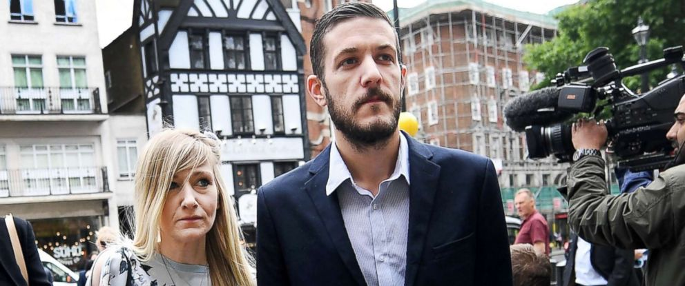 PHOTO: Parents of critically ill baby Charlie Gard, Connie Yates and Chris Gard arrive at the High Court with a spokesman in London, July 14, 2017.