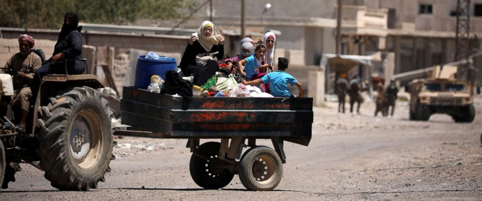 PHOTO: People are seen fleeing Raqqa, Syria, July 31, 2017.