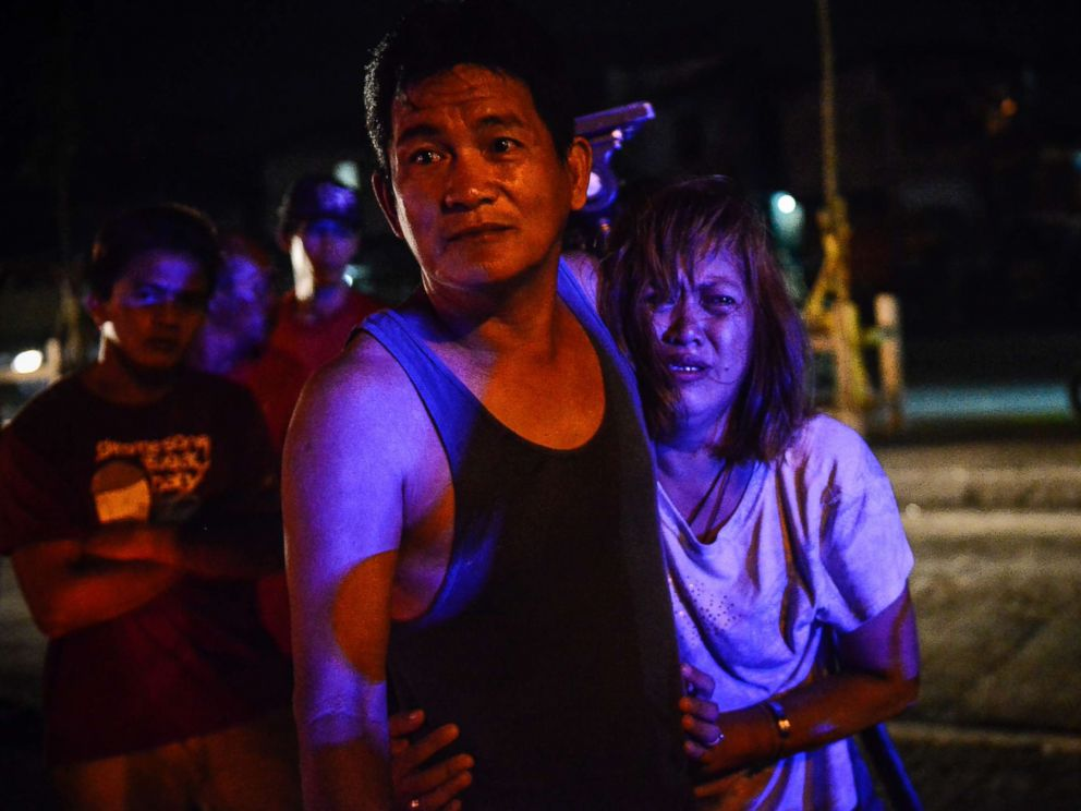 PHOTO: The parents of Irish Glorioso weep after learning their son was shot dead by unknown assailants in Navotas, north of Manila, Philippines, June 8, 2017. Drug-related killings continue as President Rodrigo Duterte marks his first year in power.