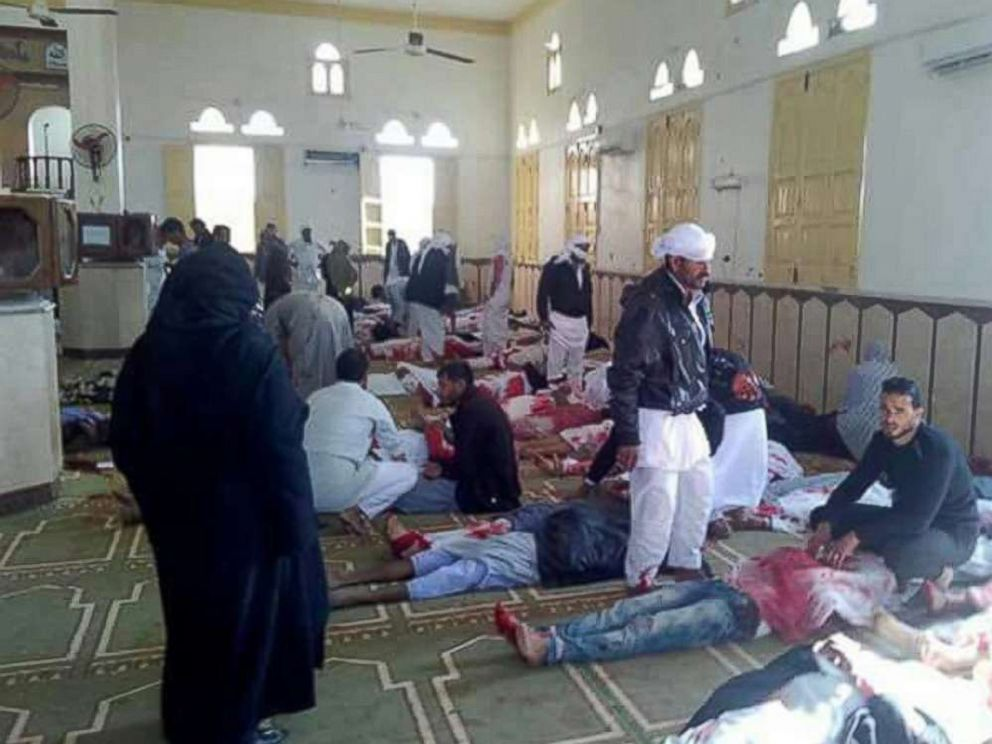 PHOTO: People sit next to bodies of worshipers killed in attack on mosque in the northern city of Arish, Sinai Peninsula, Egypt, Nov. 24, 2017.