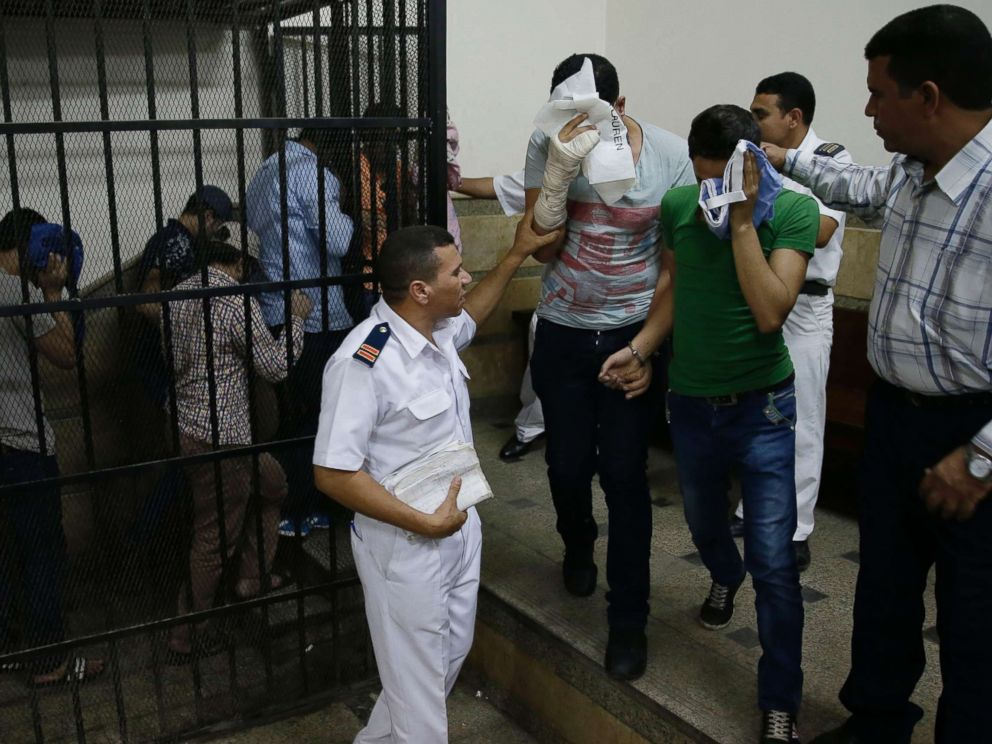 PHOTO: Eight Egyptian men convicted for inciting debauchery following their appearance in a video of an alleged same-sex wedding party on a Nile boat leave the defendants cage in a courtroom in Cairo, Egypt, Nov. 1, 2014.