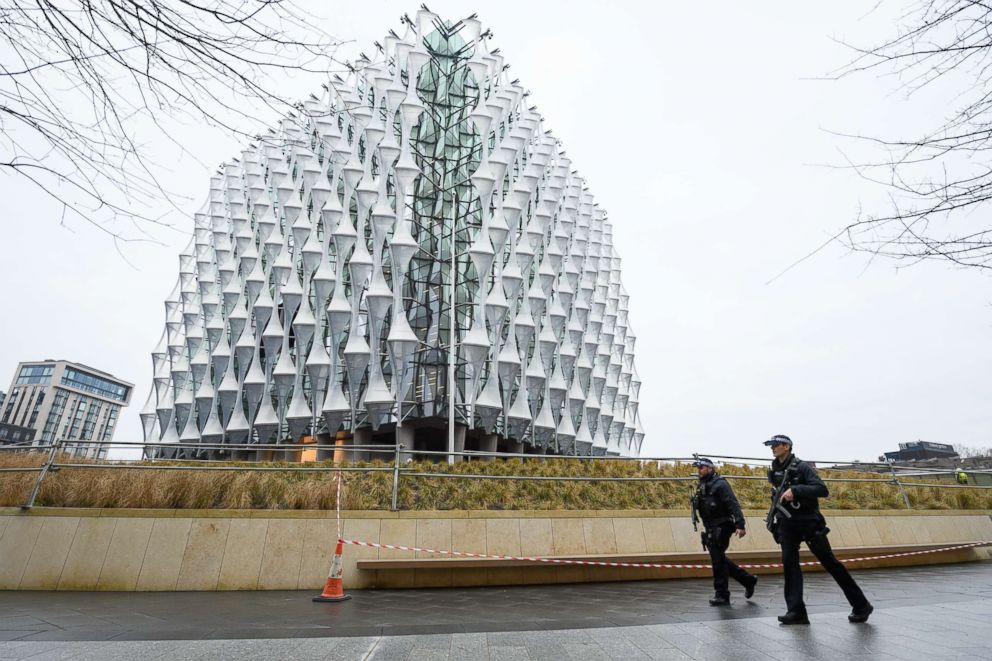 PHOTO: Armed police patrol outside the new U.S. Embassy as soldiers prepare to raise the American flag for the first time, Jan. 12, 2018 in London.
