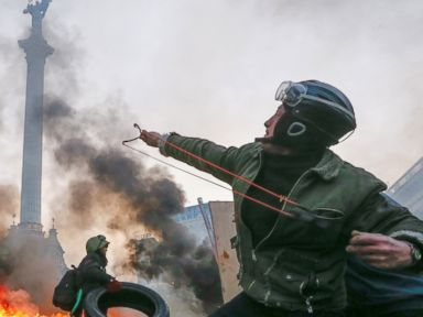 PHOTO: A protester uses a slingshot during clashes with riot police in downtown Kiev, Ukraine, Feb. 19, 2014.