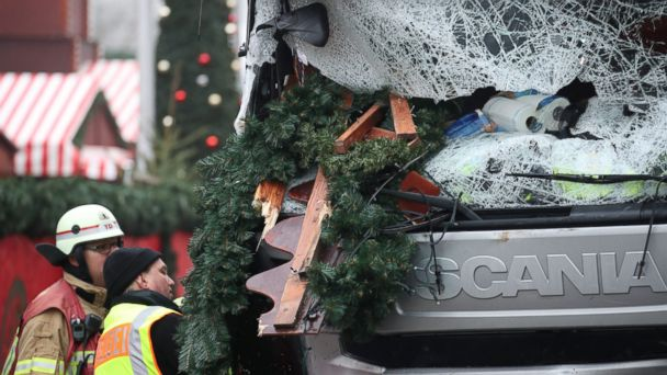 PHOTO: A police officer and fireman inspect the truck that plowed into a busy Christmas market in Berlin, Dec. 20, 2016.