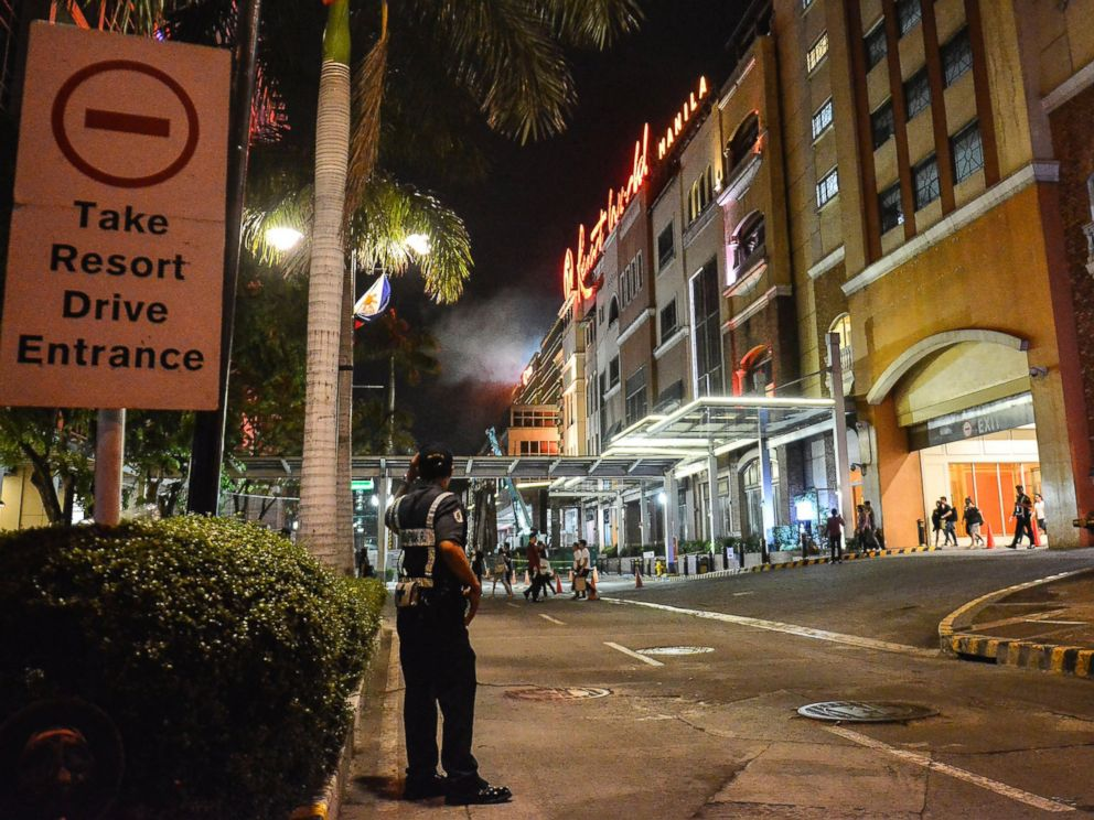 PHOTO: A Filipino policeman stands guard outside the Resort World Manila hotel in Pasay City, Philippines, June 2, 2017.