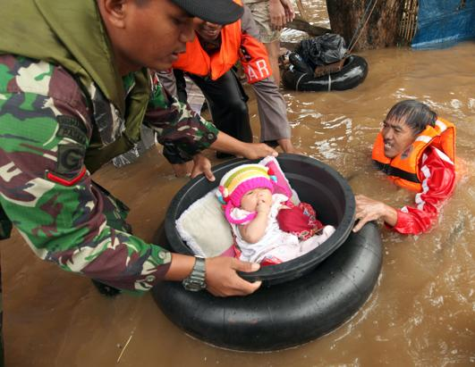 epa 16 today in pictures nt 13018 ssh Today in Pictures: Jakarta Floods, Australian Wildfires, Las Vegas Gun Show