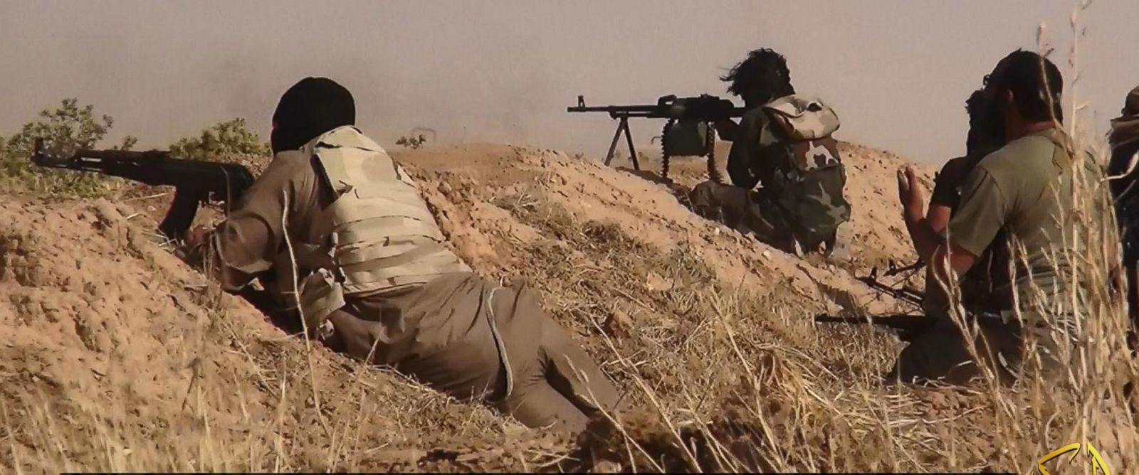 PHOTO: A photograph released by the jihadist affiliated group Albaraka News allegedly shows fighters from the Islamic movement ISIS aiming at advancing Iraqi troops at an undisclosed location near the border between Syria and Iraq, 12 June 2014.