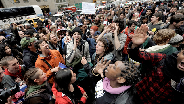 PHOTO: People gather on a sidewalk during a May Day protest in New York, New York, May 1, 2012. People around the world are gathering for May Day protests against austerity measures and calling for higher wages.