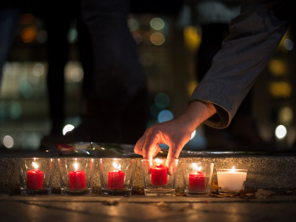 PHOTO: People light candles in tribute to the victims of the Paris attacks, outside the French embassy in Berlin on Nov. 13, 2015.