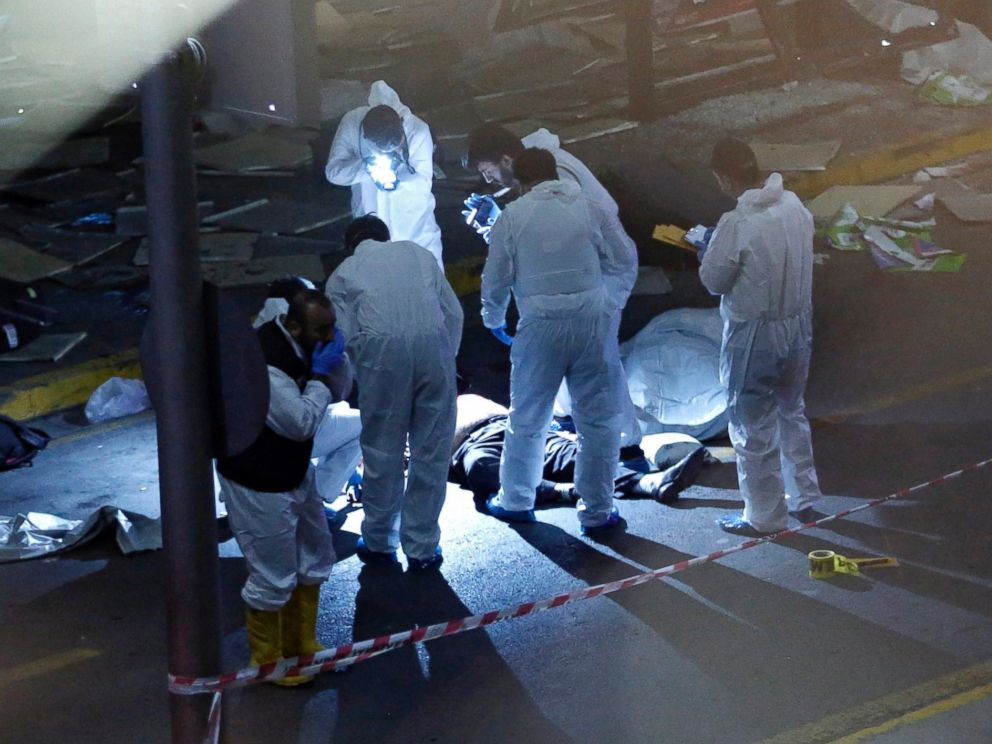 PHOTO: Crime scene investigators work next to a body after an attack at Ataturk Airport in Istanbul, Turkey, June 28, 2016.