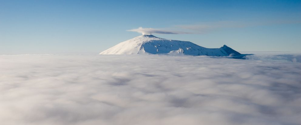 PHOTO: Mount Erebus emerges from the clouds, Dec. 10, 2016, in Antarctica. Erebus is the southernmost active volcano in the world.