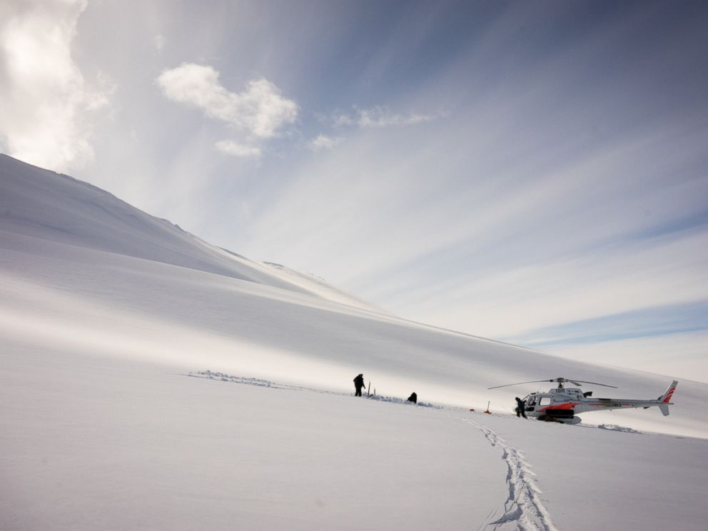 PHOTO: Dr. Graham Hill and Dr. Virginie Maris install a geophysics sensor on the flanks of Mt. Terror in Antarctica.