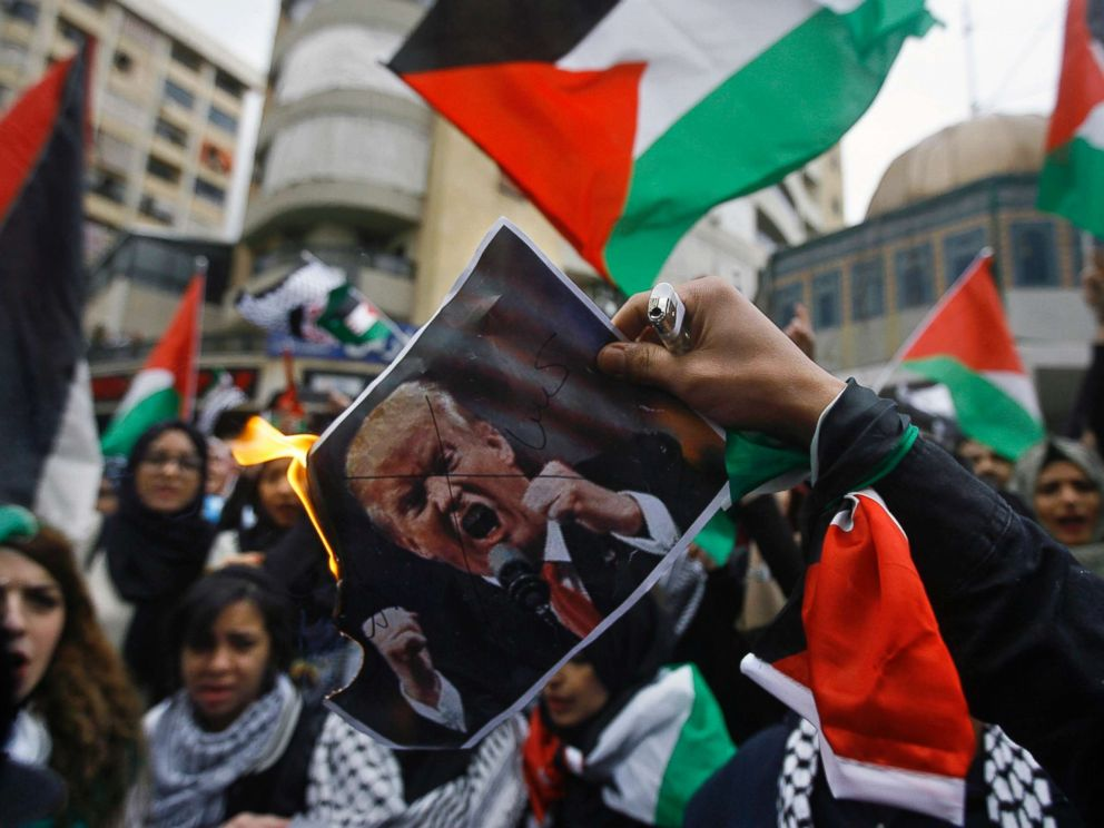 PHOTO: Lebanese and Palestinians students, burn a poster of U.S. President Donald Trump as they take part in a protest, in the southern port city of Sidon, Lebanon, Thursday, Dec. 7, 2017.
