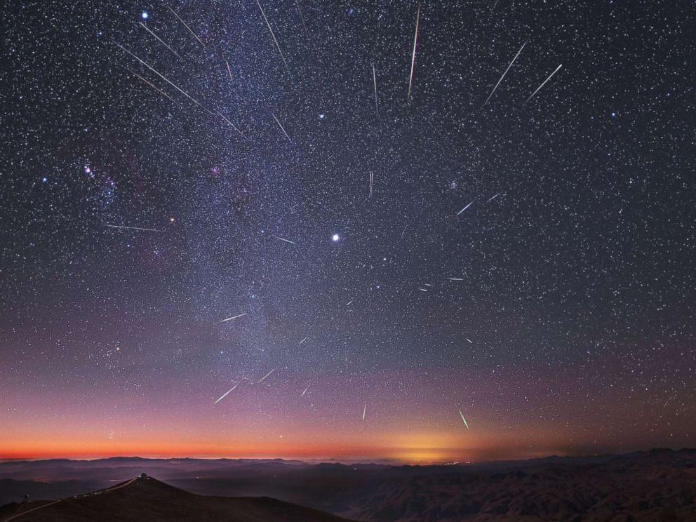 PHOTO: The radiant Geminid meteor shower over the Carnegie Las Campanas observatory, south of Atacama desert, Chile. Dec. 14, 2013, taken using a long exposure. The brightest object close to center is Jupiter and Milky Way is at left.