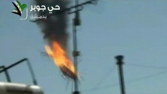 VIDEO: Government helicopter appears to have been shot down by opposition fighters.